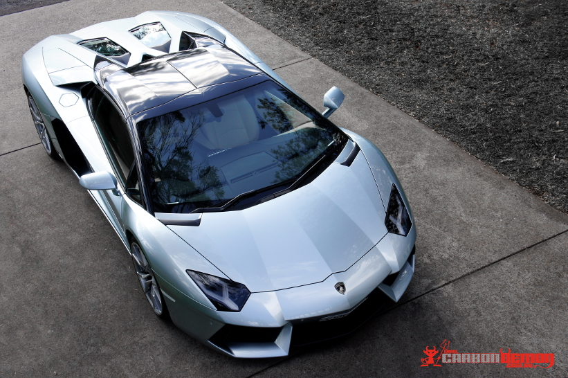 Lamborghini Aventador (gloss black vinyl wrap targa tops)